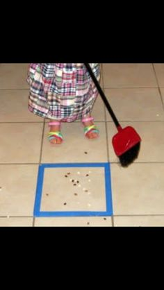 "So going to do this. Make it a fun ""game"" for kids to sweep. Tape off square and get them to sweep everything into that square."