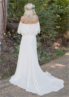Bohemian bridal gown with train and crocheted lace that can be worn on or off the shoulder. Dress Design: Daughters of Simone ---> http://www.weddingchicks.com/2014/05/10/bohemian-forest-themed-wedding-ideas/