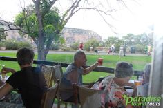 The outdoor lounge/dining area of the El Tovar Hotel at South Rim is a great place to hang with friends and family. Details: https://paradisefoundtours.com/blog/grand-canyon/el-tovar-stands-sentinel-south-rim/