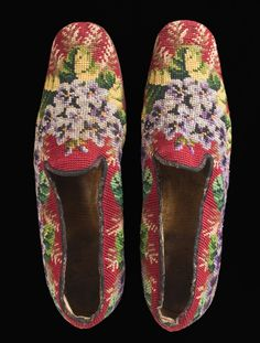 Man's slippers, Europe or U.S., 1850-1900. Linen canvas with wool needlepoint (Berlin work), and leather Overall: 3 1/4 x 3 1/8 x 10 5/8 in. LACMA.