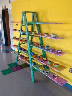 The old ladder we made pretty to display first grade pinch pots  for an elementary school art night.