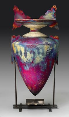 Greg Milne, now retired, potter owner of Raku Vessels.  A few remaining pieces can be found at ARA Gallery & Interiors.  Contact info is:   4850 Armar Dr. SE   Cedar Rapids, IA 52403 319-366-2520    tony@aragallery.net     www.rakuvessels.com site no longer working.  Wide Ridge Vessel