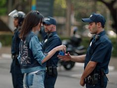 Pepsi's new ad shows Kendall Jenner joining a protest and giving a cop a soda  and people are furious (PEP)