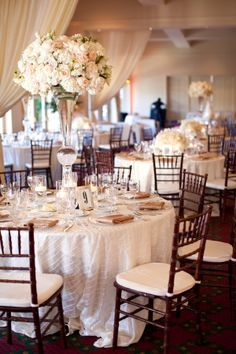 Tall Cream and Blush Reception Floral Arrangements Tall center pieces are great because they add beauty to the table while still allowing guests to talk with out the centerpiece getting in the way.