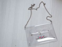 Clear vinyl bag with chain strap and small studs makes it easy to find your items.. DIY the look yourself: http://mjtrends.com/pins.php?name=clear-vinyl-material-for-bag_1