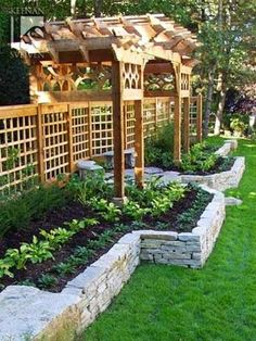 do this for a raised vegetable garden in the front yard by the house - minus the trellis and fencing