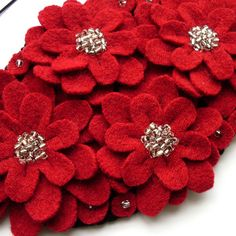 Red felted flower fascinator made from an old (shrunken) wool sweater and beads from a disused bracelet.