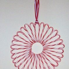 Candy canes made into a wreath.  Affordable and fun craft for the kids to make.