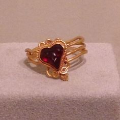 Greek snake ring with a garnet heart; Hellenistic Greece, 2nd-1st century BC.