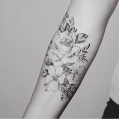 Beautiful floral forearm piece by Tritoan Ly