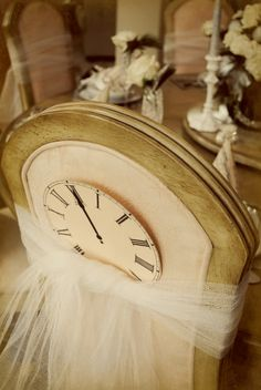 Decorate backs of dining chairs with tulle & clocks for a New Year's Eve themed dinner party from Whimsy: November 2010.