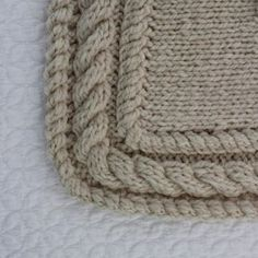This is a wonderful technique for joining a band to a piece of work.  Three needle bind off.  Rachael Rabbit:Love the border edging