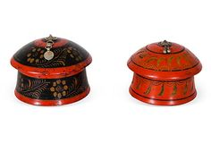 Set of two Indonesian boxes with removable lids. Hand-painted black on red and red on black. Cut and stamped tin ornament on top