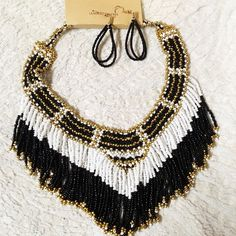 Native American fringe hippie necklace earring set Beaded Native American fringe necklace earring set. Very cute n boho. Great statement piece  ❤️All sales are FINAL!!  I sell on many platforms, so if you LIKE something BUY before it's gone. All new clothing @ affordable prices Jewelry Necklaces