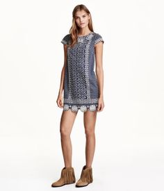 Short, straight-cut dress in woven cotton fabric with an embroidered pattern at front and on cap sleeves. Concealed zip at back. Lined.