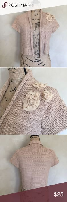 """CAbi short sleeve shrug cropped cardigan This is a cute little shrug or short sleeve cardigan sweater from CAbi. Size medium and the color is tan. Approximate length is 16.5"""" and approximate chest measurement is 18"""". CAbi Sweaters Shrugs & Ponchos"""
