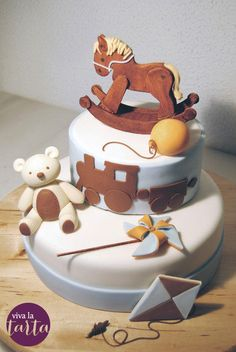 All decoration and modeling is done in fondant The rocking horse is made of pastillaje and hand painted.