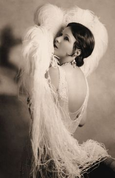 Norma Talmadge in a magnificent beaded gown and plumed fan.  Designer: Clare West