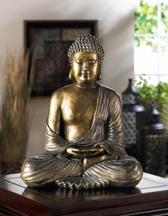 This beautiful Buddha statue will bring a calming influence into your living space with fantastic style. Deep in meditation, Buddha is seated in the lotus position with eyes closed, and his bronzy, me