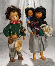"""Pair, 16"""" Bisque artist dolls by Sylvia Natterer with original costumes, and baby. $1100/1500"""