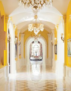 A brilliant pigment of yellow frames the art-lined gallery of this Dallas home. Design by Kelli Ford and Kirsten Fitzgibbons.