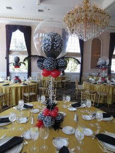 www.elegant-balloons.com - beautiful damask with ostrich feathers and crystals centerpiece
