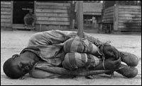 A young man is punished in a forced labor camp in Georgia in the 1930s.