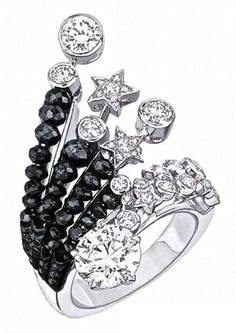 Chanel Series of fine jewelry 1932 Collection. Onyx & Diamond Ring. Available at the Chanel Fine Jewelry Boutique at London Jewelers, Americana Manhasset. For more information, please call (516) 918-2700 to speak to a Chanel Fine Jewelry representative.
