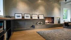 The living-room level, floored with white oak planks, is sunken, and its quiet composition is completed by a very handsome, formally minimal fireplace finished with light, leathered Loire limestone above and, lower down, an expanse of chiselled black basalt