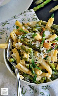 Brie and Asparagus Pasta-(!5 Copycat Recipes) A macaroni and cheese loaded with fresh saut´ed asparagus smothered in a rich, creamy, garlicky brie sauce. This delicious pasta dinner is inspired by Trader Joe's shells with brie and asparagus.
