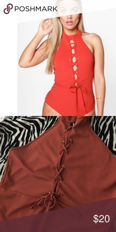 Plus size lace body suit!! Halter style! Lace up! Plus size body suit.. Beautiful rust color. Great for fall. Boohoo Plus Tops