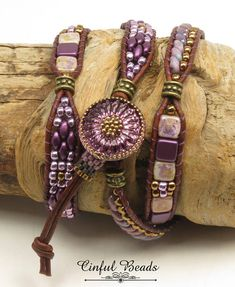 A stylish Bohemian leather wrap bracelet. This bracelet features Czech glass beads in amethyst tones. It utilizes superduos, two hole tiles, Toho seed beads, and Czech Hawaiian flower beads. They have all been stitched onto 1.5mm natural red brown leather. The clasp is a handmade