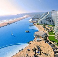 The Crystal Lagoon at San Alfonso Resort in Chile has the World's largest pool which holds 66m gallons of water and is so big you can even sail boats on it.