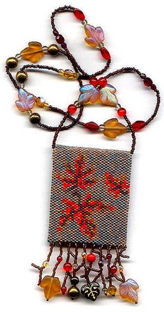 https://flic.kr/p/7KBc77   Autumn Leaves Beaded Amulet Bag Beaded Necklace   This was designed by Amy Loh- Kupser and made by me.