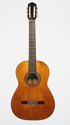 Guitar Workshop of Manuel Ramírez  (Spanish, 1864–1916) Date: 1912 Geography: Madrid, Spain Medium: Spruce, rosewood, cedar Dimensions: Total L. 96.5 cm (37 5/8 in.); L. of body 47.9 cm (18 7/8 in.); L. of string 68 cm (26 3/4 in.); L. of lower bouts 26.9 cm (10 9/16 in.); L. of middle bouts 18.9 cm (7 7/16 in.); L. of upper bouts 22.1 cm (8 3/4 in.)