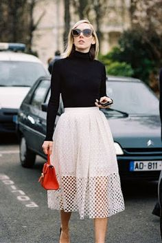 Black turtleneck + light skirt.