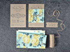 Simple but very pretty brown card invite with summery fabric wrapped around the card with string.