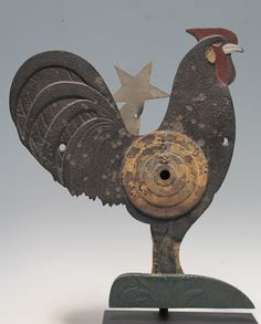 ARCADE ROOSTER WITH TARGET Rare cast iron rooster with bulls eye target with spring loaded tin star behind.Great original paint with signs o...