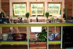 The Webers' homemade barn sash windows have leather-lace fasteners; an open cupboard adds a built-in look to the gardener's utility sink.
