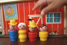 The Farm Family. Here are the little people with one of the houses. Hopefully I can get another with the things you stick them in