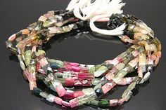 1strand  multy tourmaline faceted rectangle sized 7 by 9mm by 3yes