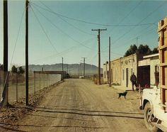 Presidio California Edward Steichen, conservateur au MoMA de New York lui achète trois tirages alors qu'il n'a que 14 ans. Dès 1971, le Metropolitan Museum de New York présente son travail et le MoMA en 1976. (// & ≠ Walker Evans) L'enregistrement de l'architecture et du paysage urbain est poussé à l'extrême avec la série sur Amarillo, éditée en cartes postales. Publiée en 1982, auj rééditée et enrichie, qui présente 70 photos couleur réalisées de 1972 à 1993 voyages à travers USA