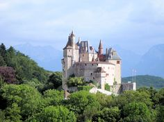 The majestic Chateau de Menthon-Saint-Bernard, near the shores of Lake Annecy.  For ideas of beautiful places and scenery to visit for your cycling trip to France, click here: http://www.pushcycling.com