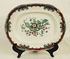 """Stoneware China, small platter, with """"Botanical"""" makers mark. CIRCA: Late 19th Century DIMENSIONS: 9"""" h x 11.375"""" w"""