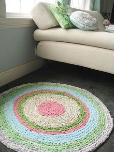 Aimee Ray from LitteDearTracks crocheted thisstunningrag rug from strips of old sheets and fabric. Aimee says:     .. It was fun to crochet with such a giant crochet hook, round and round and round. I didn't use a pattern, but this tutorial was quite helpful.
