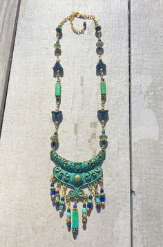 Tribal Elegance Necklace. Beautiful Patina Focal by Zola Elements with Mykonos, Czech, Picasso, and faceted beads.