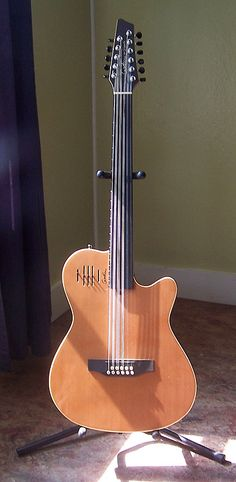 """I've pulled the frets out of guitars I've found in the trash and monkeyed with them, but I've always wanted a proper fretless. This is a """"Glissentar"""" made by Canadian company Godin. It's an 11 nylon string fretless guitar, designed forOud players. It certainly takes some getting used to, and string changes are a bear, but it's pretty amazing."""