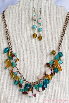 Gorgeous statement necklace with blue, amber and teal crystals and glass beads. 20% off and free shipping!