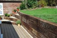 Image result for scaffold boards for garden retaining wall