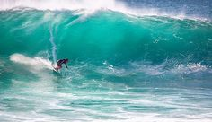 "Big wave surfing is a discipline within surfing where experienced surfers paddle into or are towed onto waves which are at least 20 feet (6.2 m) high, on browse boards referred to as ""guns"" or towboards. Sizes of the board had to effectively surf these..."